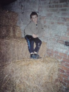 My son Josh in our hay barn
